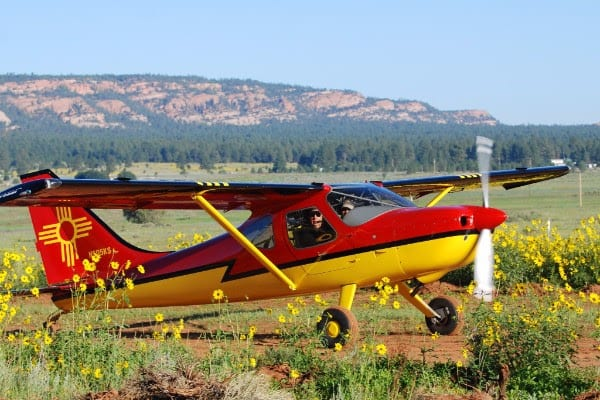 A New Mexico pilot enjoys the beautiful scenery at the Mystic Bluffs airstrip. (Photo by Joyce Woods)