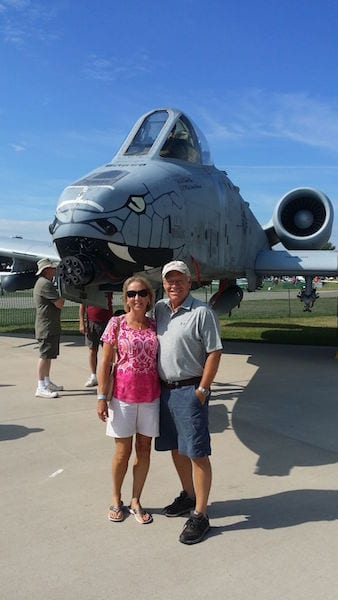 Larry Robbins and his wife, Karen, pause for a photo at the 2016 Oshkosh Airshow. His love of aviation at a very young age led him to pursue a career as an Aeronautical Engineer.