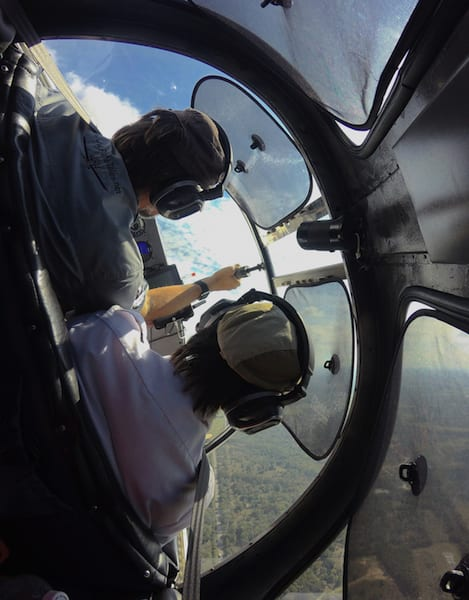 Inside Race 53's cockpit on the racecourse as the plane turns sharply around the virtual pylon at Turn 1 above Granger Lake dam. The race plane is banking at approximately 75-degrees rounding the turn. (Photo by Lisa F. Bentson)