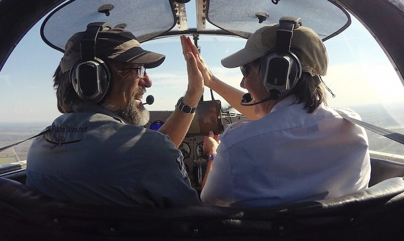 A high five over the finish line as Air Racer William E. Dubois and copilot Lisa F. Bentson complete the last race of the 2016 Sport Air Racing League season. (Photo by Lisa F. Bentson)
