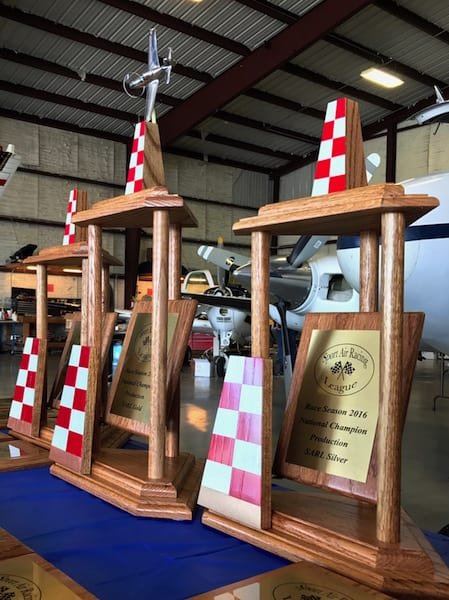 Foreground: The season champ trophy Air Racer William E. Dubois won after the Rocket 100. Center: The trophy he had his sights set on all season long. It went to his rivals, Team Ely, who took home season Gold for the fifth time in a row. (Photo by Lisa F. Bentson)