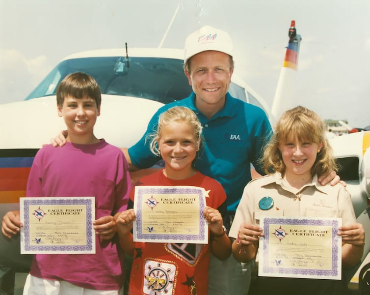 The first Young Eagles Kenny Tason, Lesley Poberezeny, and Audra Judy with then EAA President Tom Poberezeny