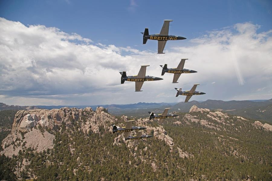 The team flying over Mt. Rushmore