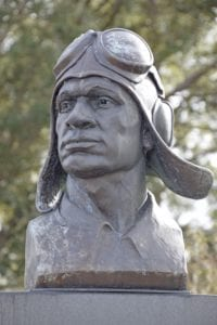 The bust of a Tuskegee Airman atop the main memorial marker.